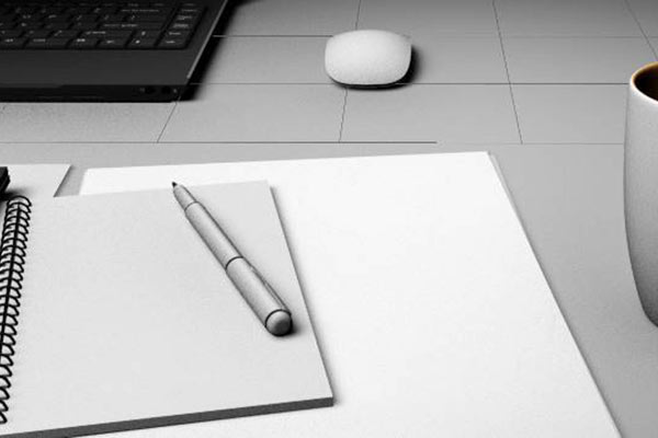 Image of pen and notebook on desk